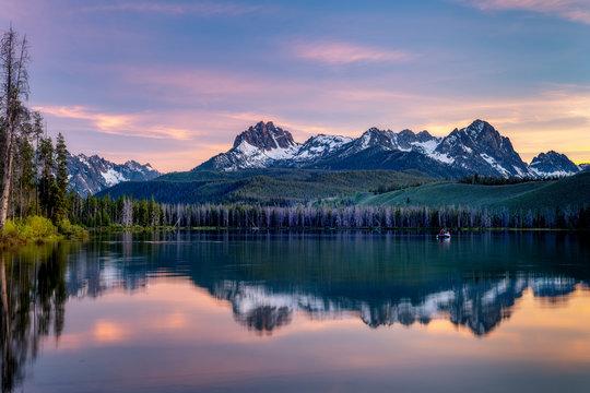 Fishing boat in Little Redfish Lake in Idaho at sunset