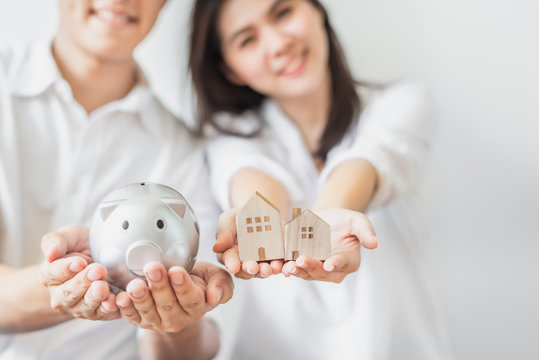 Couple saving money for buying new house concept