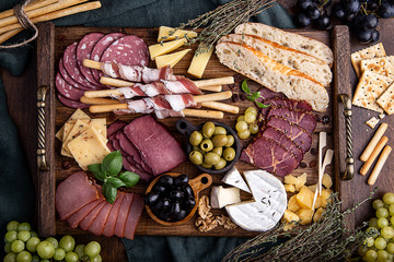 cold cuts with olives, cheese and grapes