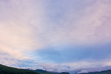 overcast purple sky above the mountain ridge at dawn. beautiful nature background
