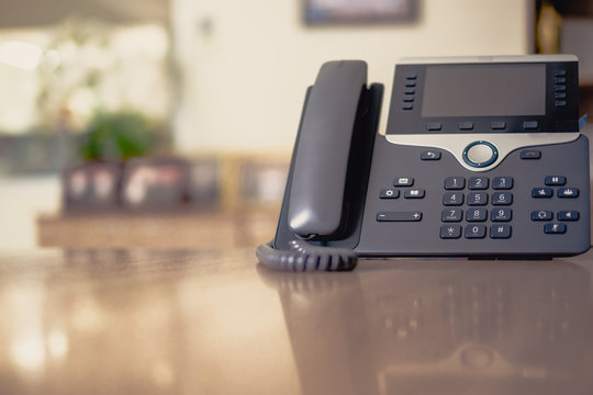 Close up soft focus on ip phone devices at office desk,Cocept business work.