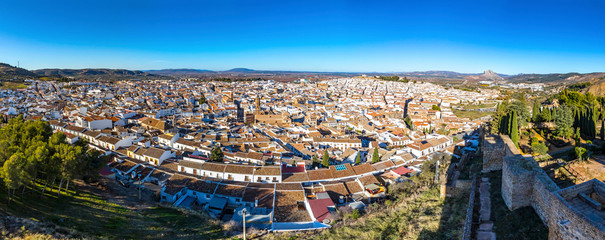 Panoramic aeria skylinel view of Antequera city, province of Malaga, Andalusia, Spain. Famous tourist and cultural center. Mountain Pena de los Enamorados (The Lovers Rock) on the right on background