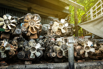 Pile old machine parts and scrap metal of car engine at second hand machinery shop. Wall mural
