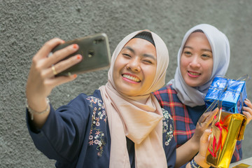 Portrait of two hijab best friend taking selfie together