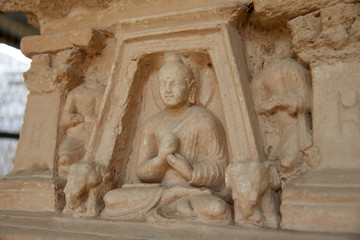 The sedentary statue of Buddha at a niche on the wall of the stupa base, Jaulian archaeological Complex, in the Khyber Pakhtunkhwa Province of Northern Pakistan