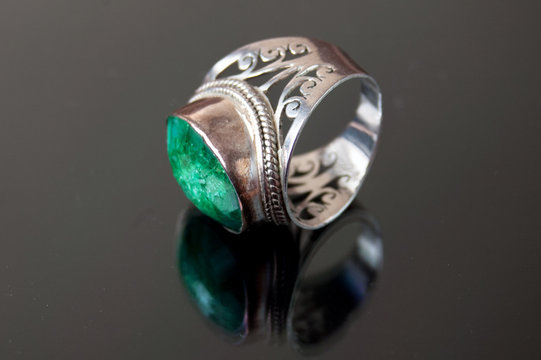 Eastern model emerald big silver ring on black background