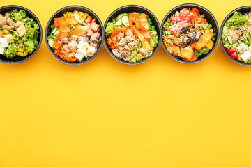 Many containers with delicious food on color background