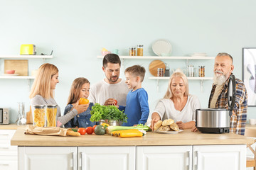 Happy family with modern multi cooker in kitchen