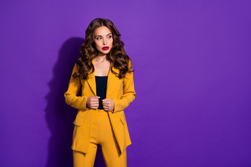 Obraz Photo of confident businesswoman touching her blazer while isolated with purple background - fototapety do salonu