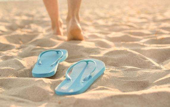 Flip-flops on sand beach at resort