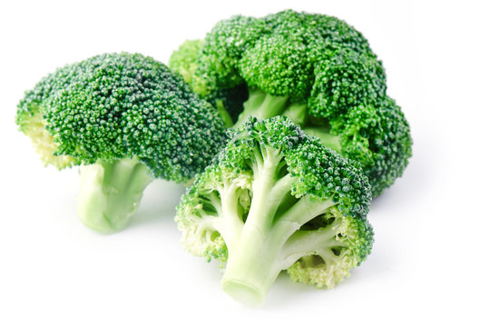Fresh raw broccoli on a white background, side view. The concept of healthy food, diet, sulforaphane, cruciferous vegetables