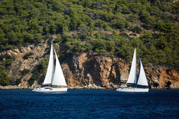 Sailing ship yachts with white sails in the Aegean sea - Greece..