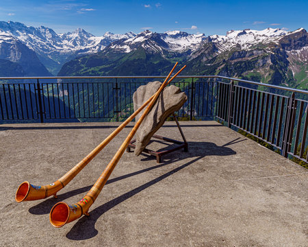 Alpine horn with the Swiss Alps in the background