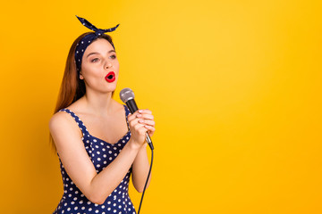 Portrait of her she nice-looking attractive lovely cheerful cheery straight-haired girl artist singing popular melody soul jazz isolated on bright vivid shine yellow background