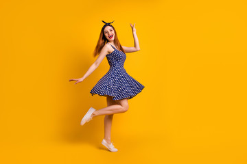 Full length body size view of her she nice-looking attractive lovely smart glad cheerful cheery straight-haired girl having fun free time isolated over bright vivid shine yellow background