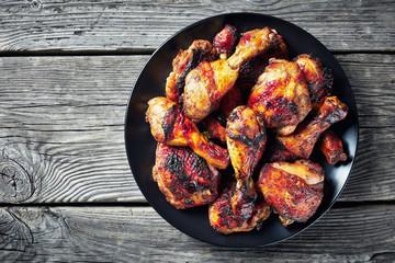 spicy Jerk Chicken on a black plate