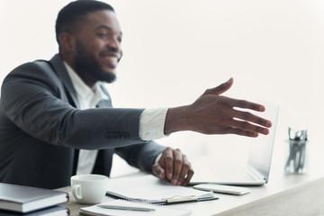 Fototapete - African American businessman extending hand to shake