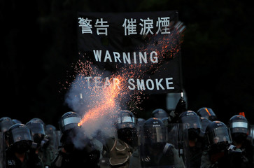 Police fire tear gas at a demonstration in support of the city-wide strike and to call for democratic reforms at Tai Po residential area in Hong Kong
