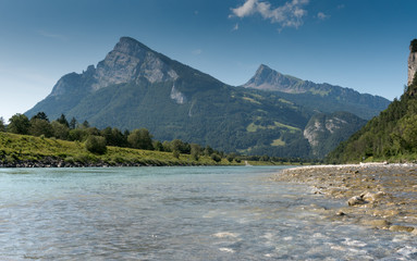 Wall Mural - river and mountain landscape with a great view in high summer