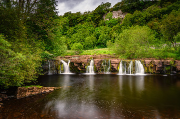 Long Exposure of Wain Wath Force, a waterfall situated on the River Swale in the Yorkshire Dales National Park and flows beneath the limestone cliffs of Cotterby Scar