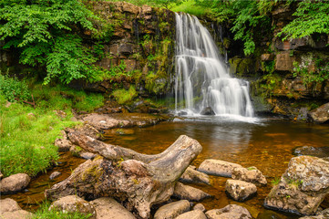 Upper East Gill Force, is a waterfall situated at the foot of East Gill near Keld in Swaledale and alongside the Pennine Way a popular spot with walkers