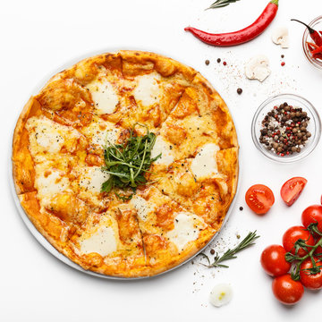 Hot cheesy italian pizza and spices on white table