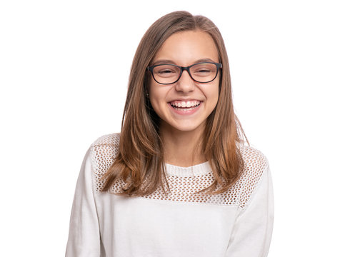Beautiful caucasian teen girl with eyeglasses, isolated on white background. Schoolgirl laughing and looking at camera. Happy smiling child - emotional portrait close-up.