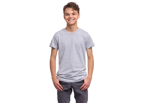 T-shirt design concept. Teen boy in blank gray t-shirt, isolated on white background. Mock up template for print. Happy child looking at camera, front view.