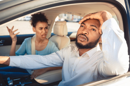 Missed road. Afro couple arguing during their journey