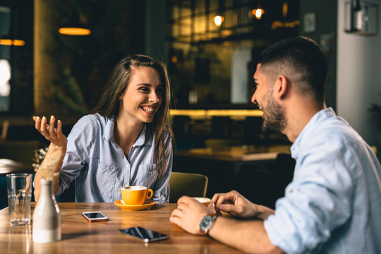 man and woman talking in cafeteria