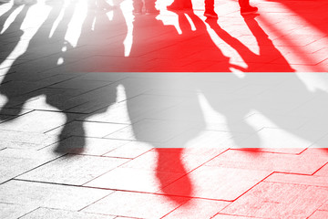 Austrian Flag and Shadows of People - concept Picture about freedom, independence, refugees, government in Austria