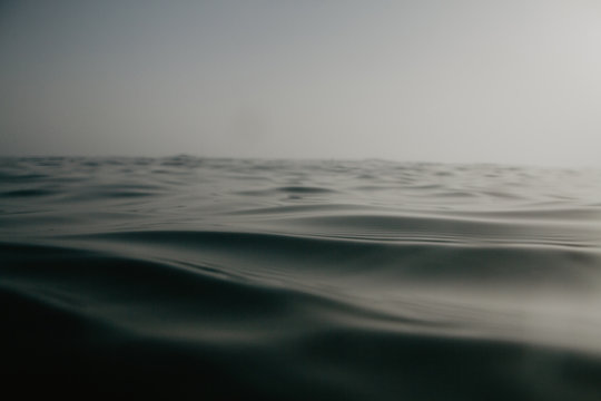 Close up of the waterline inside the mediterranean sea. Relax sunset in the water. Neutral colors