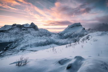 Landscape of Snowy mountain with colorful sky at sunrise Fototapete