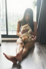 girl with cat sleep near window
