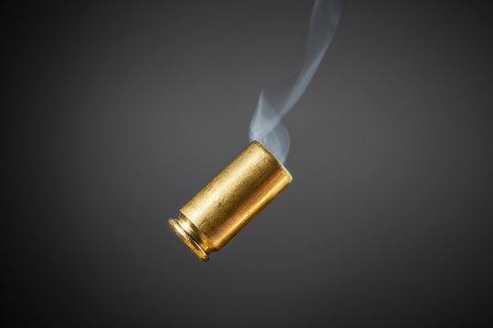 smoking bullet casing tumbling