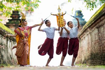 Fototapeta Thailand traditional or cultural dance in Thai costume. Thai beautiful girl is dancing called Khon, it is noble Thai art of elegance. obraz