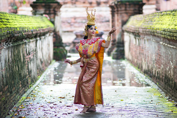 Thailand traditional or cultural dance. Thai beautiful girl is dancing called Ram, it is noble Thai art of elegance.