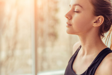 Young woman doing breathing exercise Wall mural