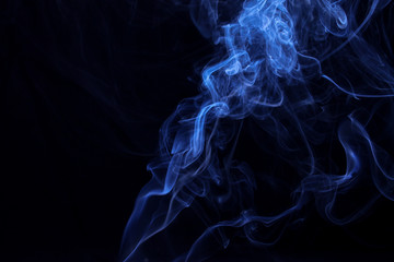 Movement of smoke on black background, blue smoke background, picture on wallpaper, design concept