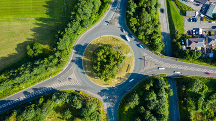 Aerial long exposure of traffic on a roundabout in a small town Wall mural