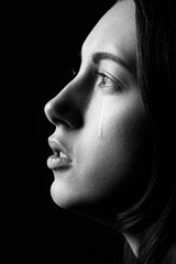 Profile of young woman crying, black and  white