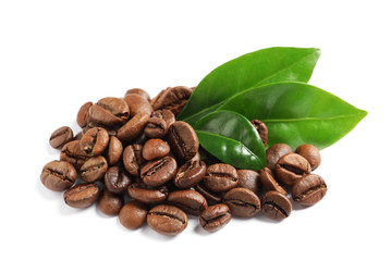 Poster de jardin Salle de cafe Roasted coffee beans and fresh green leaves on white background
