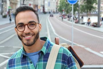Cute Latino man smiling outdoors