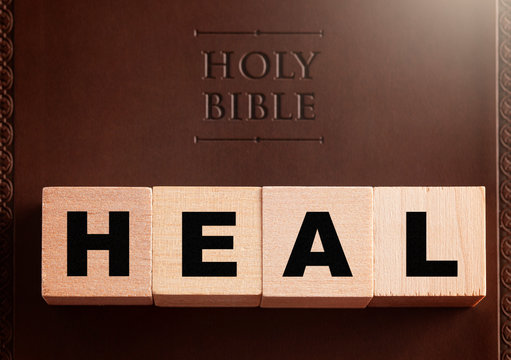 Heal Spelled in Blocks on a Leather Holy Bible