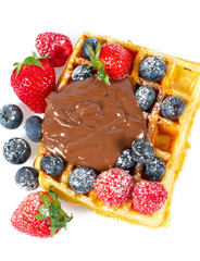 belgian waffles with berries and chocolate cream