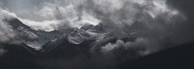 Whistler - Panorama of Dramatic Snow Covered Alpine Peak Surrounded by Storm Clouds