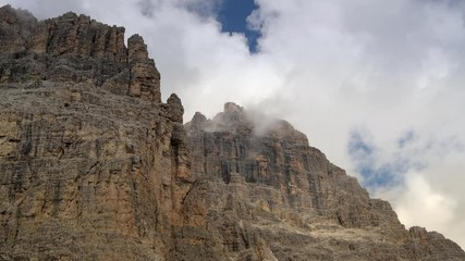 Wall Mural - Italian Dolomites Geology. Scenic Mountains Covered by Clouds.