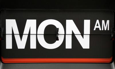 Close-up Flip clock label Monday,Time concept..