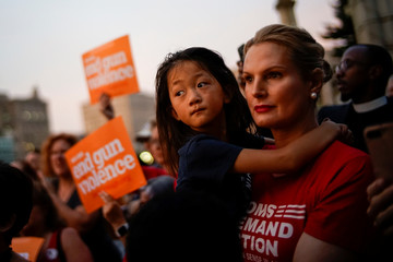 People gather for a vigil to remember victims of the mass shootings at Dayton and El Paso, at Grand Army Plaza in Brooklyn, New York