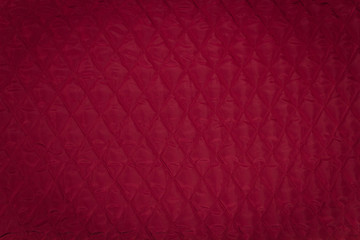 Quilted fabric. The texture of the blanket. Wall mural